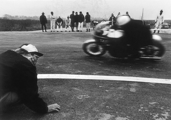 Soichiro Honda sensing the track and his motorcycles